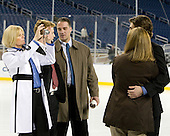 Kelly Geoffrion takes some family pictures while Blake Geoffrion (Wisconsin - 5) is still surrounded by photographers. - The Hobey Baker was awarded to Blake Geoffrion of the Wisconsin Badgers in a ceremony at Ford Field on Friday, April 9, 2010, in Detroit, Michigan.  Maine Black Bear Gustav Nyquist and UNH Wildcat Bobby Butler were also members of the Hobey Hat Trick (three finalists).