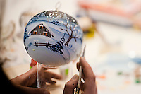 A hand painted bauble given the finishing touches