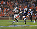 Ole Miss' Brandon Bolden (34) runs vs. Auburn defensive back Demetruce McNeal (12) at Jordan-Hare Stadium in Auburn, Ala. on Saturday, October 29, 2011. .
