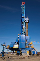 Yamal Peninsula, Russia, 08/07/2010..Drilling a new well-head in the Gazprom Yamal Bovanenkovo gasfield project, with completed well head in foreground.