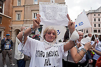 Roma 24 Giugno 2015<br /> Gli insegnanti protestano contro le riforme della scuola di Renzi, vicino  al Senato, dove giovedi il Governo Renzi ha deciso di votare la fiducia alla legge.<br /> Rome June 24, 2015<br /> The teachers are protesting against Renzi's school reforms, , close to the Senate, where the government Renzi, thursday decided to vote confidence to the law.