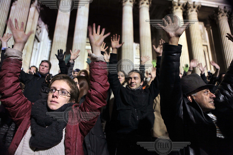 Protestors outside St Paul's Cathedral perform a 'silent scream' as the 6pm eviction deadline for their moving on passes. This was part of the Occupy London protest outside St Paul's Cathedral in the City of London. The rally is part of a worldwide protest against the banking industry and the present economic system.