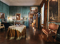 Gilded furniture and plush curtains and soft furnishings create the grandeur of a bygone age in an ante-room of the Hotel Residenza Napoleon in Rome