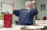 At a meeting on April 8, 2003,  in New Castle, Ind., Mothers Against Saddam Hussein (MASH) coordinator Anna Goodwin shows her enthusiasm when hearing about money the group has raised in support of the troops in Iraq.