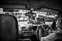 A taxi driver in Yangon, Myanmar.