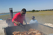 Charleston, South Carolina<br /> October 26, 2013<br /> <br /> Internationally renowned chefs and local barbecue masters attending the Cook It Raw barbecue on Bowens Island.