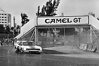 Bobby Rahal drives a Zakspeed Roush Ford Mustang Turbo through the rain during the 1983 IMSA race on the streets of Miami, Florida.