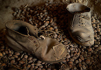 Goreme, Cappadocia, Turkey, July 2005. Old shoes and a variety of other goods were left behind by the last owner, in the Roman Grave. Dutch Photographer Frits Meyst and his wife Jillian Macdonald restored an old rock house in the village of Goreme. Since Roman Times people have been cutting graves and home out of the Soft tufo 'Fairy Chmney' rocks of Cappadocia. Photo by Frits Meyst / MeystPhoto.com