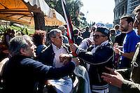 Roma 25 Aprile 2014<br /> Tensioni fra comunit&agrave; Ebraica di Roma  e attivisti pro Palestina al corteo per la Liberazione dal Nazifascismo dell'Anpi.  Un manifestante della comunit&agrave; ebraica cerca  di strappare una bandiera palestinese a dei manifestanti pro Palestina<br /> Rome April 25, 2014 <br /> Tensions between the Jewish community of Rome and pro-Palestinian activists during the  march for the Liberation of Nazi-fascism by the National Association of Italian Partisans. A protester of the Jewish community (R)  tries to snatch a Palestinian flag to the protesters pro-Palestinian