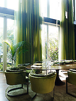 Sheer draperies in Kravet's leaf tones wrap the dining room in nature's hues, while a Saarinen table is surrounded by soft, moss-coloured velvet chairs by Verden. delicate pendants dangle like stars in Swarovski's crystal chandelier.