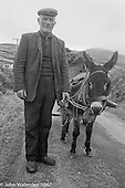 "Donkey cart carrying peat, Dunquin (in Gaelic, Dún Chaoin, meaning ""Caon's stronghold""), on the tip of the Dingle Peninsula, County Kerry, Ireland.  1971."