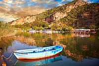 Ferry row boat on the Dalyan Çay River looking towards boats & fish restaurant. Mediterranean coast Turkey