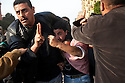 A pro-Mubarak protester is held in a head lock by an anti-Mubarak protester after being captured during clashes between the two sides on the edge of Tahrir Square February 02, 2011in Cairo Egypt. Both sides battled for control of the square which has been at the center of more than a week of ongoing protests..(Photo by Scott Nelson)