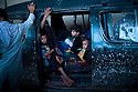 A family sit and wait in their car in a traffic jam inside the Salang tunnel in the Parwan province. Even though in very bad shape, the road through the Salang Pass is the only major route over the Hindu Kush mountains linking southern Afghanistan to the north and Central Asia that remains open throughout the year. Afghanistan, 2012