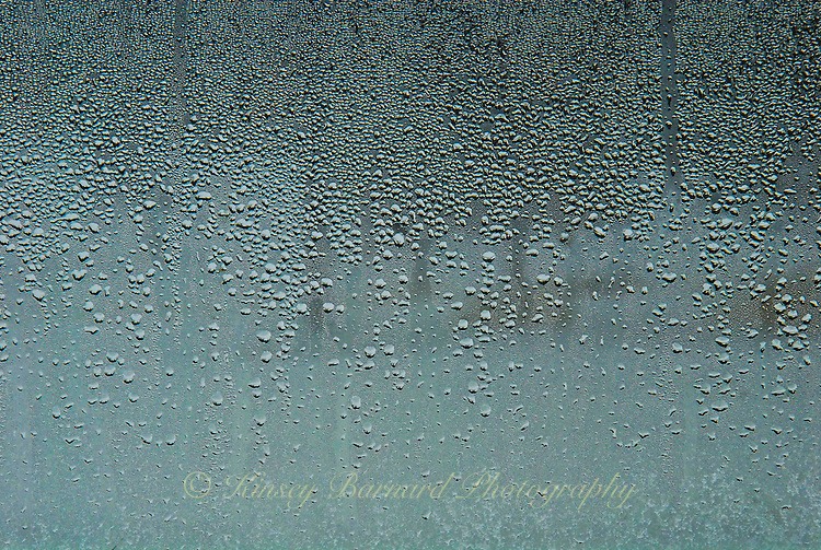 &quot;WATER DROP LANDSCAPE&quot;<br /> <br /> Water drops on window panes with a winter landscape barely visible beyond.