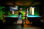 Puerto Ricans play pool at a bar in the mountainous town of Jayuya, Puerto Rico, on Friday, November 14, 2008.
