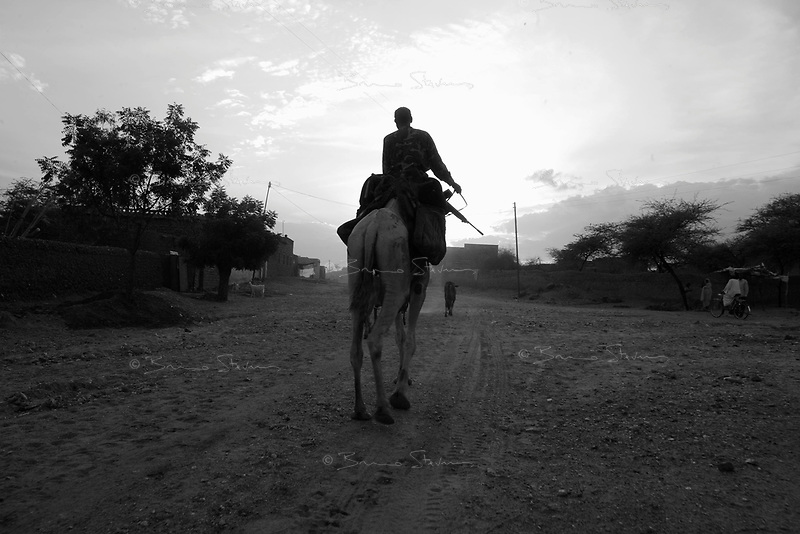 Kutum, North Darfur, August 23, 2004.A Janjaweed camel rider in the city.