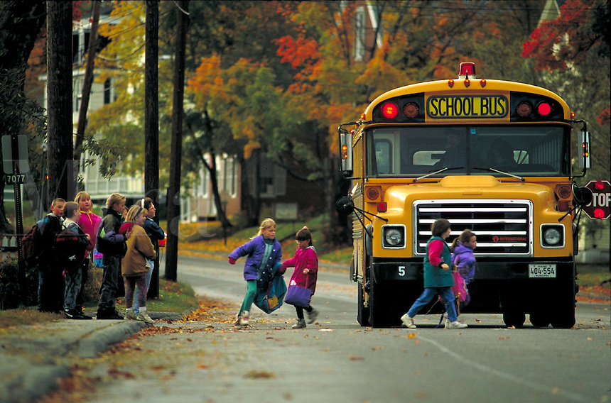 Children being dropped off by the school bus.