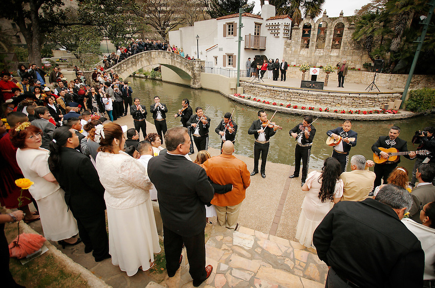 """We do!"" said 400 couples on San Antonio's romantic River Walk during Valentine's Day mass weddings. This annual exchange of love draws couples from across the nation to one of the country's most passionate cities. Here, mariachis perform romantic serenades on the bank of the meandering San Antonio River. (Darren Abate/pressphotointl.com)"