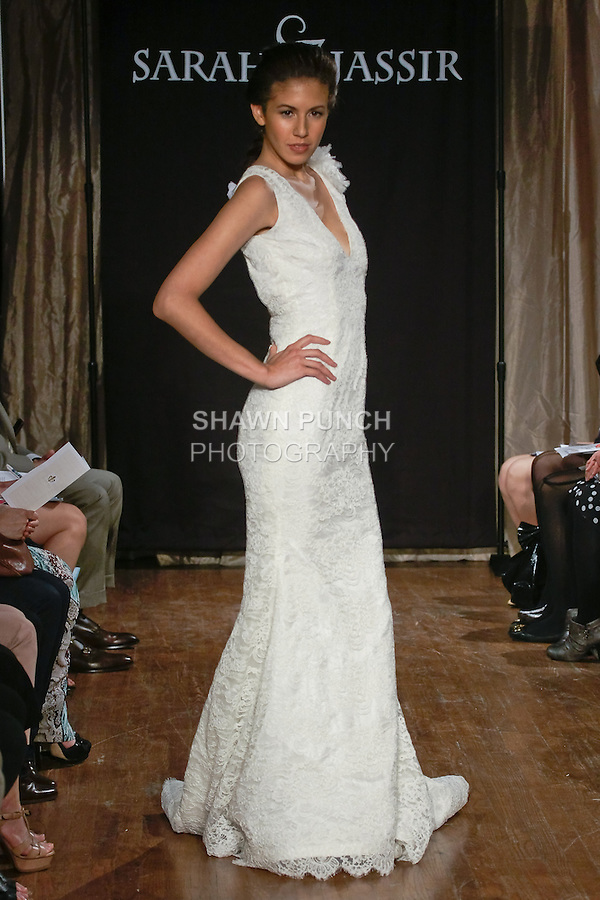 "Model walks runway in a Juliette Bridal dress - V-neck lace mermaid gown with keyhole back, by Sarah Jassir, for the Sarah Jassir Spring 2013 ""La Reve: The Dream"" collection, during Bridal Fashion Week New York."