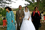 A newly married Kurdish Iraqi couple pose for photographs at their wedding reception outside Irbil, Iraqi Kurdistan...Stability and security prevail in postwar Iraqi Kurdistan as Iraqi tourists, many of them from Baghdad, flock to the northern cities and their amusement parks and national parks to escape violence and sectarian strife in the central and southern regions of the country.