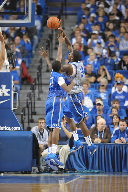 Junior DeAndre Liggins shoots over Freshman Doron Lamb during the UK mens basketball Blue/White scrimmage. Photo by Mike Weaver | Staff