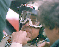 Harry Gant sits in his car as he talks with members of his crew at the Atlanta Motor Speedway, Hampton, GA, before the ATlnata Journal 500, November 11, 1984.  (Photo by Brian Cleary/www.bcpix.com)