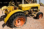 Old, yellow tractor with flat tires, Arizona