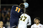 12 December 2014: Virginia's Eric Bird (11) heads the ball over UMBC's Kay Banjo (17). The University of Virginia Cavaliers played the University of Maryland Baltimore County Retrievers at WakeMed Stadium in Cary, North Carolina in a 2014 NCAA Division I Men's College Cup semifinal match. Virginia won the game 1-0.