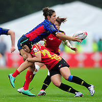 Lourdes Alameda of Spain offloads the ball. FISU World University Championship Rugby Sevens Women's 7th/8th place match between Spain and PR China on July 9, 2016 at the Swansea University International Sports Village in Swansea, Wales. Photo by: Patrick Khachfe / Onside Images