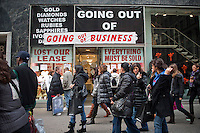 A store going out of business on Fifth Avenue in midtown in New York on Friday, November 26, 2010. (© Frances M. Roberts)
