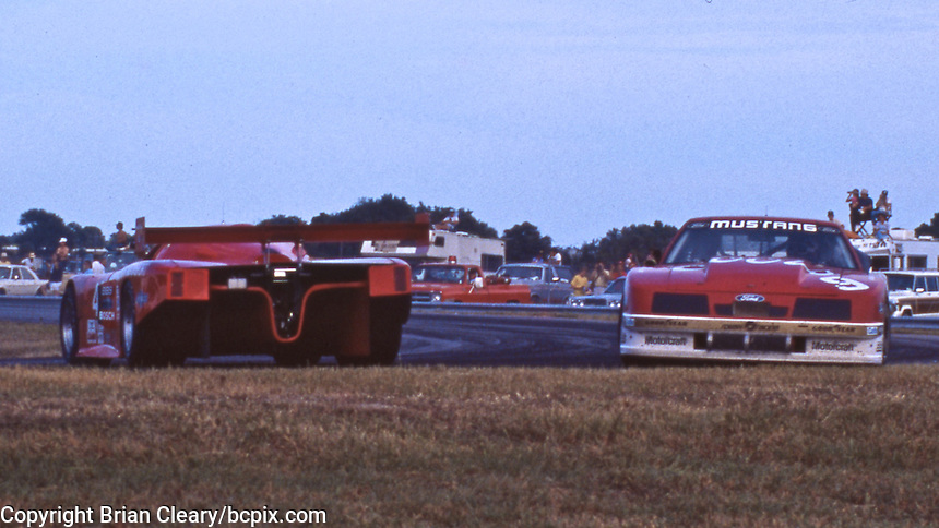 NASCAR legend Bill Elliott drives the #9 Roush Ford Mustang past a spinning prtotype in the IMSA Eastern Airlines 3 Hour Grand Prix, Daytona International Speedway, Daytona Beach, FL, October 26, 1986.  (Photo by Brian Cleary/www.bcpix.com)
