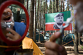 A Nashi youth loyal to Chechchen strongman Ramzan Kadyrov shaves his beard at a summer camp on Lake Seliger in Russia. The yearly camp, organised by the nationalistic group supporting Russian Prime Minister Vladimir Putin, trains youth in political activism.