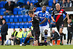 St Johnstone v St Mirren....06.10.12      SPL.Nigel Hasselbaink is fouled by Paul Dummett.Picture by Graeme Hart..Copyright Perthshire Picture Agency.Tel: 01738 623350  Mobile: 07990 594431