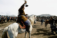 """The Winner in a Buzkashi between North East Afghans in the National stadium of Kabul..""""bOzkashI"""" is one of the ancient games played in Afghanistan. The name of this game is perhaps derived from hunting mountain goats by ancient champions n horseback."""