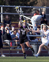 University at Albany midfielder Nikki  Branchini (10) on the attack as Boston College attacker Moira Barry (12) defends. University at Albany defeated Boston College, 11-10, at Newton Campus Field, on March 30, 2011.