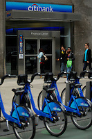New York, USA. 28 May 2014. Citi bike are seen in at a rental location next to a citibank office during the one year anniversary in New York. Photo by Eduardo Munoz Alvarez/VIEWpress