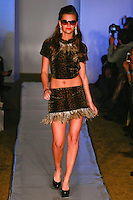 Model walks runway in an outfit from the Samina Mughal Fall 2012 Untamed Ferocious Glamour collection, by Samina Mughal, during Plitzs Fashion Week New York Fall 2012.