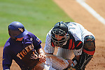 Ole Miss' Will Allen tags out LSU's Tyler Hanover  at Regions Park in the SEC Tournament in Hoover, Ala. on Thursday, May 24, 2012.  .LSU won 11-2.