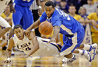 CRYSTAL LoGIUDICE/The Daily Reveille.LSU's Garrett Temple and Kentucky's Joe Crawford dive for the ball during the first half of the Wildcats victory over the Tigers at the Maravich Assembly Center in Baton Rouge on Saturday.