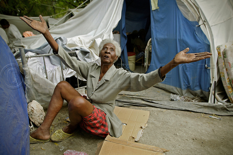 "Clairevana Desbrosses, 87, says she survived the earthquake by running under her bed and praying to God. ""I'm alive because of God."" She now lives in a tent outside of the the Municipal Nursing Home in Port-A-Prince near Delmas 2 on February 27, 2010. The nursing home was destroyed during the earthquake and now the general public has encroached on the nursing home site."