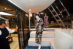 "Geisha are welcomed aboard one of Harumiya Co.'s ""yakata-bune"" pleasure boats in Tokyo, Japan on 30 August  2010. Photographer: Robert Gilhooly"