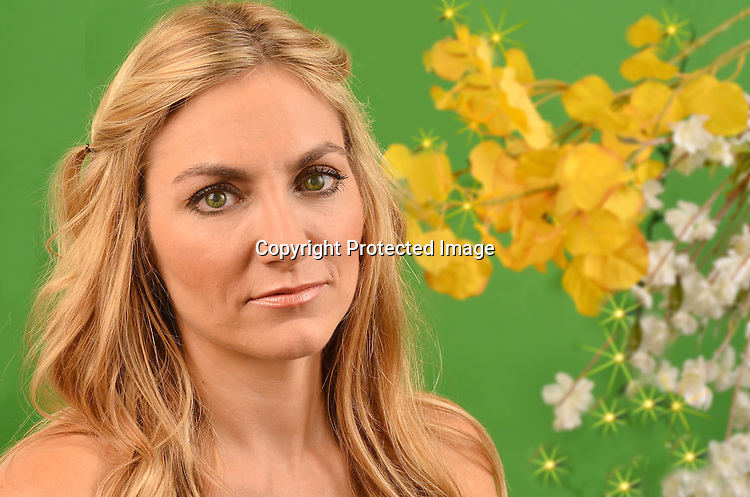Stock photo of Beautiful woman and nature in studio