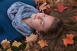 Young woman photographed in the autumn