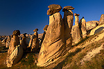 Basalt caps on eroded tufa columns, Cappadocia, Turkey