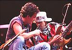 Bruce Springsteen 1985 with Nils Lofgren  LA Coliseum..© Chris Walter..