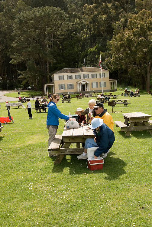 Picnic at Ayala Cove, Angel Island State Park, in San Francisco Bay, CA, California.  People disembark and picnic at Ayala Cove, then hike, bike, or tram perimeter road, with stops at Civil War era Camp Reynolds, and its restored officer house, or Spanish American War era Fort McDowell..Photo camari239-70379..Photo copyright Lee Foster, www.fostertravel.com, 510-549-2202, lee@fostertravel.com.