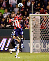 Chivas USA forward Chukwudi Chijindu (77) leaps high for a ball. CD Chivas USA defeated the San Jose Earthquakes 3-2 at the  at Home Depot Center stadium in Carson, California on Saturday April 24, 2010.  .