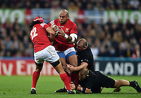 Soane Tonga'uiha of Tonga is tackled in possession. Rugby World Cup Pool C match between New Zealand and Tonga on October 9, 2015 at St James' Park in Newcastle, England. Photo by: Patrick Khachfe / Onside Images