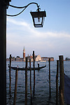 Gondola with passengers from Piazza San Marco Venice with Isola di San Giorgio Maggiore in background